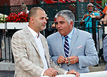 Winning trainer Gregory Sacco (R) discusses the race as Mind Control (no. 2) wins the Hopeful Stakes (Grade 1), Sep. 3, 2018 at the Saratoga Race Course, Saratoga Springs, NY.  Ridden by John Velazquez, and trained by Gregory Sacco, Mind Control finished  3/4 lengths in front of Mucho (No. 7).  (Bruce Dudek/Eclipse Sportswire)