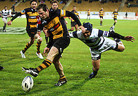 Auckland captain Benson Stanley tackles Taranaki halfback Brett Goodin as he attempts to clear. Air New Zealand Cup rugby match - Taranaki v Auckland at Yarrows Stadium, New Plymouth, New Zealand. Friday 9 October 2009. Photo: Dave Lintott / lintottphoto.co.nz