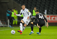 2nd January 2020; Liberty Stadium, Swansea, Glamorgan, Wales; English Football League Championship, Swansea City versus Charlton Athletic; Connor Roberts of Swansea City passes the ball under pressure from James Vennings of Charlton Athleic  - Strictly Editorial Use Only. No use with unauthorized audio, video, data, fixture lists, club/league logos or 'live' services. Online in-match use limited to 120 images, no video emulation. No use in betting, games or single club/league/player publications