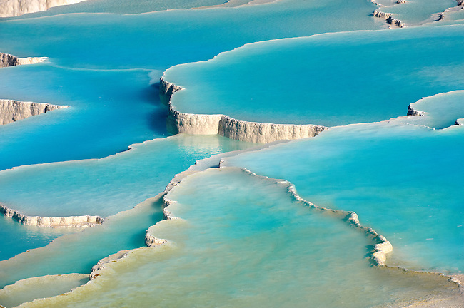 Photo & pictures  of Pamukkale Travetine Terrace, Turkey. Photography of the white Calcium carbonate rock formations. Buy as stock photos or as photo art prints. 4 Pamukkale travetine terrace water cascades, composed of white Calcium carbonate rock formations, Pamukkale, Anatolia, Turkey