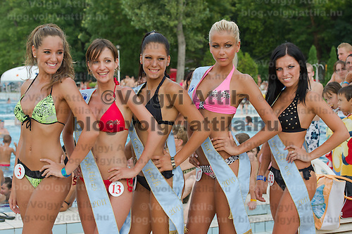 Special award winners Adrienn Lukacs (L) for best decolletage, Angela Toth (2nd L) for best bottom, Szilvia Kalman (2nd R) for best back and Evelin Szalai (R) for best face pose during the Miss Bikini Hungary beauty contest held in Budapest, Hungary on August 06, 2011. ATTILA VOLGYI