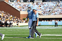 CHAPEL HILL, NC - SEPTEMBER 21: Jace Scott #10 of the University of North Carolina is assisted as he walks off the field with a game-ending injury during a game between Appalachian State University and University of North Carolina at Kenan Memorial Stadium on September 21, 2019 in Chapel Hill, North Carolina.
