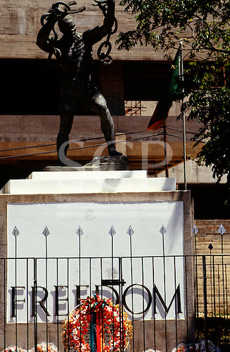 Lusaka, Zambia; 'Freedom'; statue of slave breaking his chains with colourful floral wreaths.