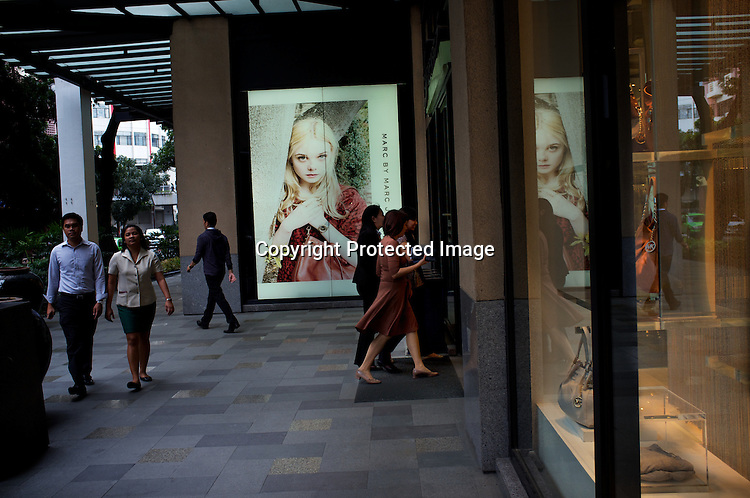 Shoppers seen walking around the Greenbelt mall in the city of Makati in the Philippines. Photo: Sanjit Das