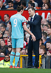 West Ham manager, Slaven Bilic speaks with Andy Carroll during the Emirates FA Cup match at Old Trafford. Photo credit should read: Philip Oldham/Sportimage