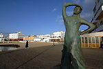 Statue dedicated to mariners and lady dressed in black, Corralejo, Fuerteventura, Canary Islands, Spain