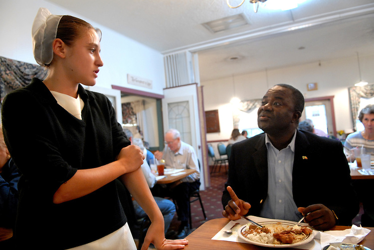 Emanuel Ohin of the Benin Embassy, talks with waitress Susan Lantz, 15,  at Dienner's restaurant in Ronks, Pa.  About 30 ambassadors, embassy staff and their families from around the world visited the congressional district of Rep. Joe Pitts, R-Pa-16.  Congressman Pitts has established himself as a leader on international issues and the Ambassador visit is one such way to build bridges between this work and his constituents.  During the trip, the ambassadors stay with host families and tour various cultural, business, and historic sites.