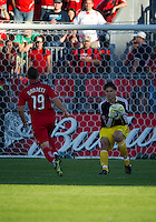 01 July 2010:  Houston Dynamo goalkeeper Pat Onstad #18 grabs the ball before Toronto FC forward Chad Barrett #19 can put a foot on it during a game between the Houston Dynamo and the Toronto FC at BMO Field in Toronto..Final score was 1-1....