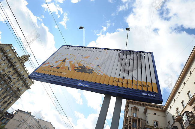 "A billboard showing Mikhail Prokhorov with the slogan ""Design your future"" turned on a street in downtown Moscow the day that he left the Right Cause political party. Russia, September 15, 2011"