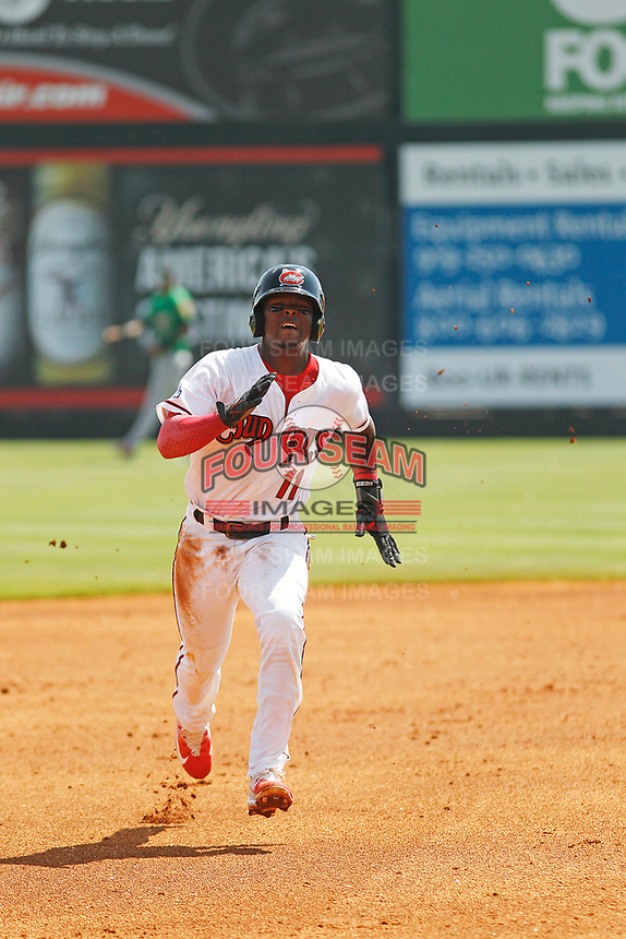 Carolina Mudcats infielder Luis Avilas (11) running the bases during a game against the Down East Wood Ducks on April 27, 2017 at Five County Stadium in Zebulon, North Carolina. Carolina defeated Down East 9-7. (Robert Gurganus/Four Seam Images)