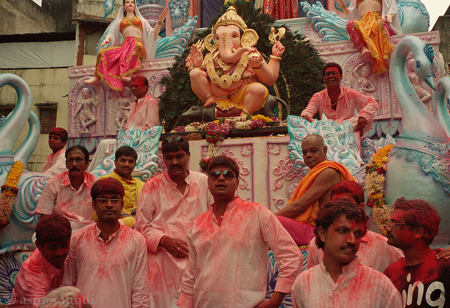 Mandap tableaux and attendants at the Ganapati Utsava