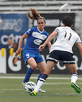 Boston Breakers midfielder Heather O'Reilly (9) on the attack.  In a National Women's Soccer League (NWSL) match, Seattle Reign FC (white) defeated Boston Breakers (blue), 2-1, at Dilboy Stadium on June 26, 2013.
