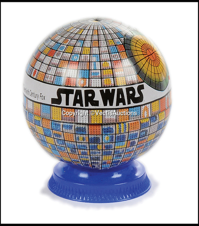 BNPS.co.uk (01202 558833)<br /> Pic: Vectis/BNPS<br /> <br /> Helix Star Wars Death Star tinplate and plastic Pencil Sharpener &pound;240.<br /> <br /> A tiny plastic rocket from a Star Wars action figure has sold for almost &pound;2,000 as part of a huge &pound;160,000 sale of rare toys relating to the film franchise.<br /> <br /> The red missile measures just 28mm long and was attached to the back of a prototype figure of bounty hunter Boba Fett.<br /> <br /> A complete prototype Boba Fett can sell for &pound;13,000 but thanks to a letter of authentication and grading by the Action Figure Authority (AFA), the small rocket made &pound;1,920 by itself at auction.<br /> <br /> It was one of almost 700 Star Wars lots that sold for &pound;160,000, with many toys that originally sold for &pound;1.50 achieving four-figure sums.<br /> <br /> With the release of Star Wars:The Force Awakens imminent, interest in memorabilia from the franchise has never been higher.