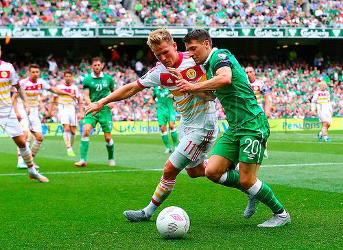 13.06.2015. Dublin, Ireland. Euro2016 Qualifying. Republic of Ireland versus Scotland. Matt Richie (Scotland) and Wesley Hooligan (Rep. of Ireland) challenge for the ball.