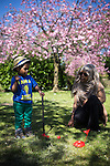© Joel Goodman - 07973 332324 . 6 May 2013 . Debdale Park , Gorton , Manchester , UK . Hakeen Mohamed (2) plays toy golf with mum Hoda Mussa (24) (both correct) . People enjoy the sunshine weather in Debdale Park , Gorton , during the Bank Holiday Monday . Photo credit : Joel Goodman