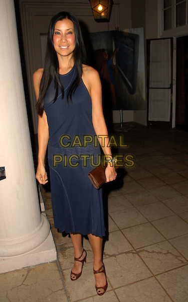 LISA LING .Batonga Foundation Hosts Star-Studded Fall 2008 Fundraiser, held The Wilshire Ebell Theatre,  Los Angeles, California, USA, 19 September 2008..full length blue dress brown shoes clutch bag .CAP/ADM/FS.©Faye Sadou/Admedia/Capital Pictures