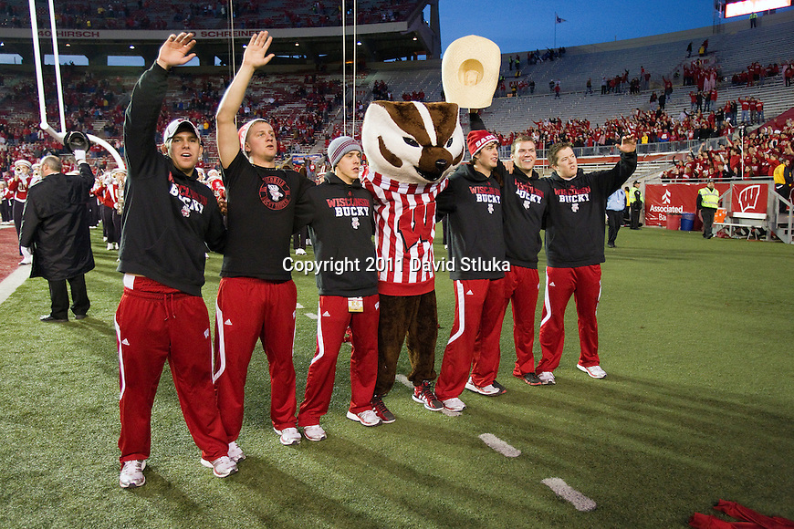 "Wisconsin Badgers mascot Bucky Badger and the Bucky staff sing Varstiy during the famed ""5th Quarter"" after an NCAA Big Ten Conference college football game against the Purdue Boilermakers on November 5, 2011 in Madison, Wisconsin. The Badgers won 62-17. (Photo by David Stluka)"