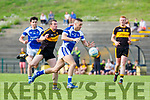 Con Barrett Kerins O'Rahilly bursts through the Dr Crokes defence with Shane Doolan in hot pursuit during the County league clash in Killarney on Saturday