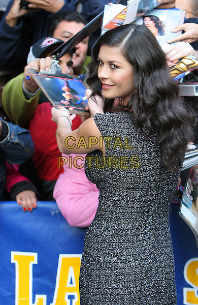 "CATHERINE ZETA-JONES.Arrives at the ""Late Show with David Letterman"", Ed Sullivan Theatre, NYC .October 18th, 2005.Photo: Jackson Lee/Admedia/Capital Pictures.Ref: JL/ADM.half length grey gray black dress looking over shoulder signing autographs.www.capitalpictures.com.sales@capitalpictures.com.© Capital Pictures."