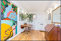 BNPS.co.uk (01202 558833)<br /> Pic: Savills/BNPS<br /> <br /> A quirky one-bed house that is less than 8ft wide has gone on the market for &pound;595,000 - the same price as a stunning five-bedroom barn conversion in Cheshire.<br /> <br /> The new owners of the unusual Noel Lodge in Ealing, west London, will have to plan their furniture carefully and certainly won't be hosting any large dinner parties.<br /> <br /> The former horse and cart entrance, which is dwarfed by the two blocks of flats either side of it, has just 560sq ft of space, which works out at &pound;1,062.50 per square foot.