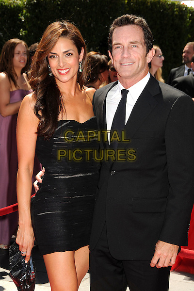 GUEST & JEFF PROBST .62nd Annual Primetime Creative Arts Emmy Awards - Arrivals held at Nokia Theatre L.A. Live, Los Angeles, CA, USA, 21st August 2010..emmys arrivals half length suit dress black tie smiling .CAP/ADM/BP.©Byron Purvis/AdMedia/Capital Pictures.