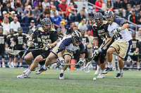 Annapolis, MD - April 15, 2017: Navy Midshipmen Brady Dove (55) tries to get the groundball during game between Army vs Navy at  Navy-Marine Corps Memorial Stadium in Annapolis, MD.   (Photo by Elliott Brown/Media Images International)
