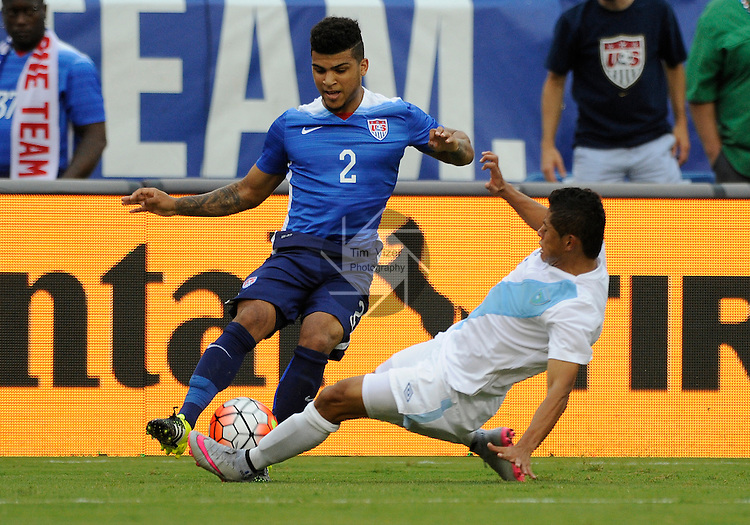 Guatemala forward Edgar Chincilla (6) slide tackles USA defender DeAndre Yedlin (2) in the second half. Guatemala played the USA Men's National Team in an International Friendly soccer game on Friday July 3, 2015 at Nissan Stadium in Nashville, Tennessee. The USA won, 4-0.