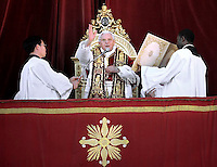 "Pope Benedict XVI delivers the Urbi et Orbi (to the city and to the world) Christmas Day message from the central balcony of St. Peter's Basilica in Vatican City, 25 December 2011. In his traditional Christmas Day message, Pope Benedict XVI urged the faithful to seek a ""spiritual union"" with the less fortunate around the world, including in Africa and Asia, where people are suffering from the effects of wars and natural disasters."
