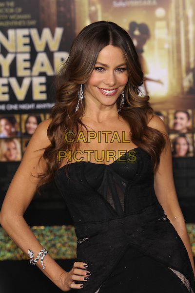 "Sofia Vergara.The World Premiere of ""New Year's Eve' held at The Grauman's Chinese Theatre in Hollywood, California, USA..December 5th, 2011.half length dress hand on hip  black strapless corset dangling silver earrings viagra .CAP/CEL .©CelPh/Capital Pictures."