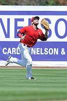 Tyler Palmer #4 of the Burlington Bees runs toward a fly ball in center field against the Lansing Lugnuts at Community Field on July 27, 2014 in Burlington, Iowa. The Lugnuts won 3-2.   (Dennis Hubbard/Four Seam Images)