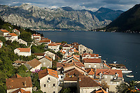 View of the medieval town of Perast and mountains in the Unesco protected Kotor bay, Montenegro, Europe