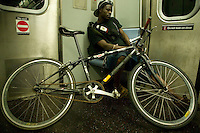 1 July 2005 - New York, USA - Victor Ouma from Brooklyn rides the L train into Manhattan, New York, USA, early July 1st 2005, on the first evening of the 13th annual cycle messenger world championships. More than 700 riders from all over the world took part in the 4-day competition which carries event based on the daily work of a city bike messenger.