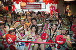 "Tokyo, Japan - Customers pose for cameras inside the Desigual store in Tokyo's Harajuku fashion district. A fashion chain called ""Seminaked Party by Desigual"" offers the first 100 customers (wearing swimsuit) free clothing items at the grand opening in Tokyo, Japan, June 22, 2013. More than 4,000 people attend the Seminaked Party around the world. (Photo by Rodrigo Reyes Marin/AFLO)"