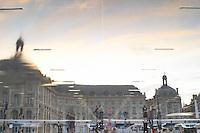 Place de la Bourse. The new fountain Miroir d'Eau, Water Mirror, making reflections. Upside down. Bordeaux city, Aquitaine, Gironde, France