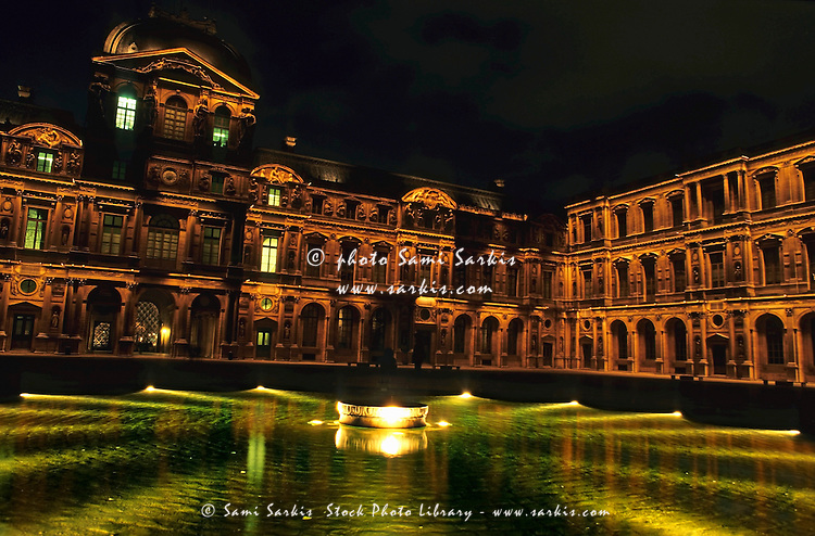 La Cour Carrée and the building of the Louvre illuminated at night, Paris, France.