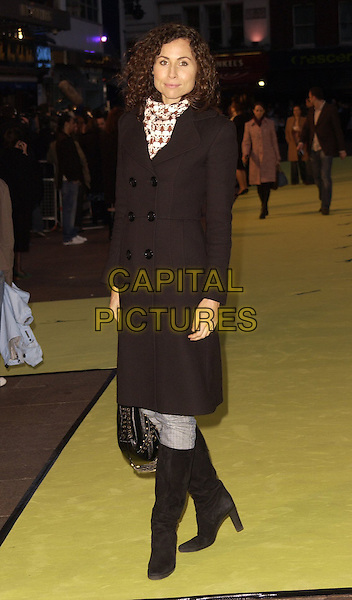 """MINNIE DRIVER.Arrivals at the World Premiere of """"Alien Autopsy"""", .Odeon Leicester Square, London, .England, April 3rd 2006..full length black coat scarf knee high boots.Ref: CAN.www.capitalpictures.com.sales@capitalpictures.com.©Can Nguyen/Capital Pictures"""