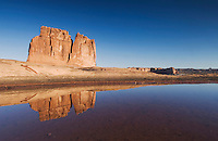 Courthouse Towers at sunrise with reflection in pot hole, Arches National Park, Utah, USA, September 2007