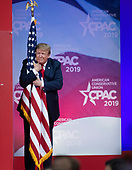 United States President Donald J. Trump hugs the American Flag as he arrives to speak at the Conservative Political Action Conference (CPAC) at the Gaylord National Resort and Convention Center in National Harbor, Maryland on Saturday, March 2, 2019.<br /> Credit: Ron Sachs / CNP <br /> (RESTRICTION: NO New York or New Jersey Newspapers or newspapers within a 75 mile radius of New York City)