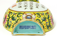 BNPS.co.uk (01202 558833)<br /> Pic: Sworders/BNPS<br /> <br /> The vital Qianlong stamp - that shows the vase was made for the Emperor and not for export.<br /> <br /> A Chinese vase which was bought for £1 in a charity shop could sell for £80,000 because it was made for a 18th century emperor.<br /> <br /> Unaware of its significance, the shopper listed the small yellow florally decorated vase on eBay to see if it was worth anything - only to be inundated with messages and bids.<br /> <br /> Realising the pear-shaped vase, which is designed to be attached to a wall, must be valuable, he removed it from the bidding site and took it to specialists at Sworders Fine Art Auctioneers' in Stansted Mountfitchet, Essex.<br /> <br /> The 8ins Qianlong famille rose vase, found in Hertfordshire, was made around 300 years ago in China and was marked with a symbol that meant it wasn't for export, but for the Emperor's palace.<br /> <br /> It is inscribed with an imperial poem that 'praises incense' and two iron-red seal marks that read 'Qianlong chen han' or 'the Qianlong Emperor's own mark'. It also reads 'Weijing weiyi' - 'be precise, be undivided'.
