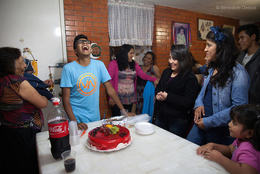 """Baruch and his family on his eighteenth birthday at his home in the Iztapalapa area of Mexico City, Mexico on July 17, 2014. Baruch Alejandro Anleu Ramirez, 18, is the captain of Guerreros Aztecas. Two years ago, Baruch had his left leg amputated due to bone cancer. He used to practice as much as his chemotherapy would allow. Expelled from school for missing too many classes during his treatment, he says, """"Guerreros Aztecas has filled a big hole in my life"""". Baruch was Guerreros Aztecas's brightest hope to represent Mexico at the Amputee Soccer World Cup. But since the cancer's spread to his lungs, he can no longer play or train with the team. Guerreros Aztecas (""""Aztec Warriors"""") is Mexico City's first amputee football team. Founded in July 2013 by five volunteers, they now have 23 players, seven of them have made the national team's shortlist to represent Mexico at this year's Amputee Soccer World Cup in Sinaloathis December.The team trains twice a week for weekend games with other teams. No prostheses are used, so field players missing a lower extremity can only play using crutches. Those missing an upper extremity play as goalkeepers. The teams play six per side with unlimited substitutions. Each half lasts 25 minutes. The causes of the amputations range from accidents to medical interventions – none of which have stopped the Guerreros Aztecas from continuing to play. The players' age, backgrounds and professions cover the full sweep of Mexican society, and they are united by the will to keep their heads held high in a country where discrimination against the disabled remains widespread.(Photo byBénédicte Desrus)"""