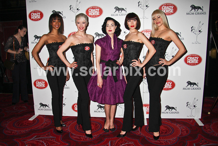 **ALL ROUND PICTURES FROM SOLARPIX.COM**.**SYNDICATION RIGHTS FOR UK, SPAIN, PORTUGAL, AUSTRALIA, S.AFRICA & DUBAI (U.A.E) ONLY**.photocall announcing that Dita von Teese to Guest Judge First American Auditions at MGM Grand's Crazy Horse Paris Hotel and Casino in Las Vegas. Las Vegas, Nevada, USA. 6th March 2008..This pic: Dita von Teese..JOB REF: 5902 PHZ    DATE: 06_03_2008.**MUST CREDIT SOLARPIX.COM OR DOUBLE FEE WILL BE CHARGED* *UNDER NO CIRCUMSTANCES IS THIS IMAGE TO BE REPRODUCED FOR ANY ONLINE EDITION WITHOUT PRIOR PERMISSION*