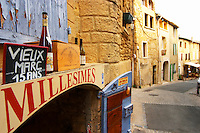 A wine shop advertising Vieux Marc - old eau de vie spirit - and wine bottles, called Millesimes - vintages. A street in the village. Chateauneuf-du-Pape Châteauneuf, Vaucluse, Provence, France, Europe Chateauneuf-du-Pape Châteauneuf, Vaucluse, Provence, France, Europe