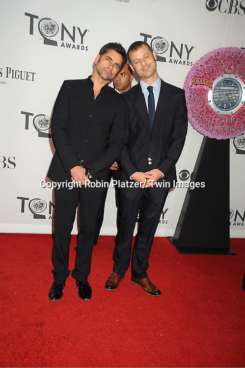 John Stamos and Matt Stone  attends th 66th Annual Tony Awards on June 10, 2012 at The Beacon Theatre in New York City.