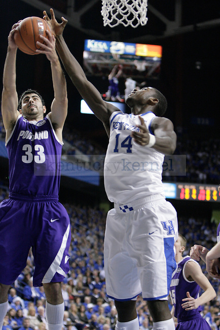 Michael Kidd-Gilchrist attempts grab a rebound against Portland at Rupp Arena on Saturday, Nov. 26, 2011. Photo by Scott Hannigan | Staff
