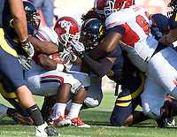D.J. Holt of California tackles Robbie Rouse of Fresno State during the game at Candlestick Park in San Francisco, California on September 3rd, 2011.  California defeated Fresno State, 36-21.