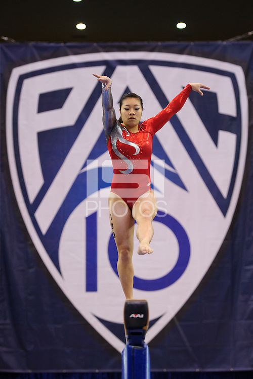 LOS ANGELES, CA - March 19, 2011:  Stanford's Danielle Ikoma competes on the balance beam during the Pac-10 Championship at UCLA's Pauley Pavilon.   Stanford placed fourth in the competition.