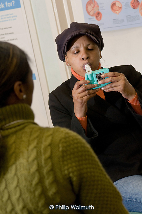Service user Annette checks her lung function at a weekly Stop Smoking group meeting at St Mary's Hospital, Paddington, London.