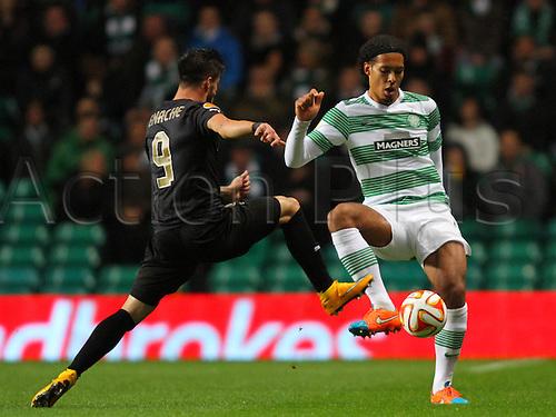 23.10.2014.  Glasgow, Scotland. UEFA Europa League. Celtic versus Astra Giurgiu. Virgil van Dijk beats Gabriel Enache to the ball