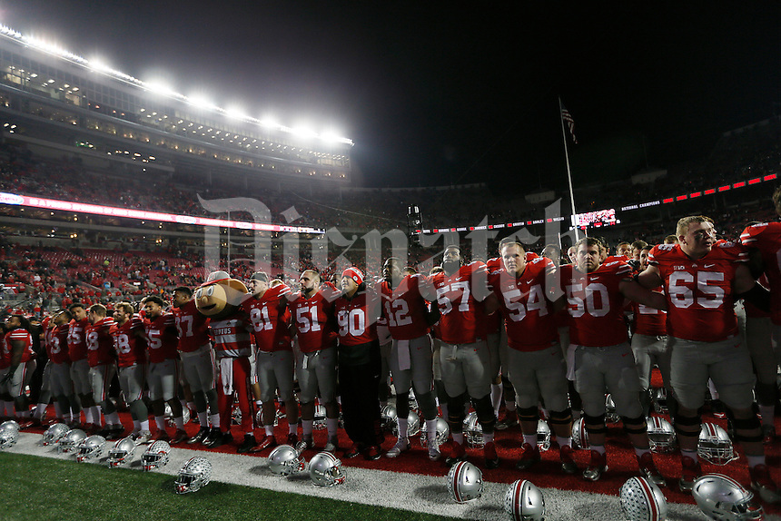 The Ohio State Buckeyes sing Carmen Ohio during the college football game between the Ohio State Buckeyes and the Minnesota Golden Gophers at Ohio Stadium in Columbus, Saturday night, November 7, 2015. The Ohio State Buckeyes defeated the Minnesota Golden Gophers 28 - 14. (The Columbus Dispatch / Eamon Queeney)