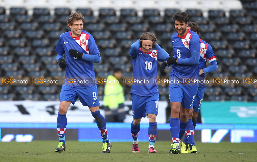 Nikica Jelavic is congratulated after scoring the 3rd goal for Croatia - Croatia vs Korea Republic, International Friendly at Craven Cottage, London - 06/02/13 - MANDATORY CREDIT: Rob Newell/TGSPHOTO - Self billing applies where appropriate - 0845 094 6026 - contact@tgsphoto.co.uk - NO UNPAID USE.
